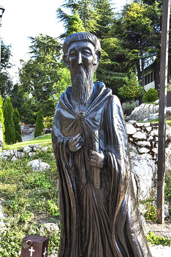 Wooden sculpture of Saint Naum in Saint Naum monastery complex, made from existing tree