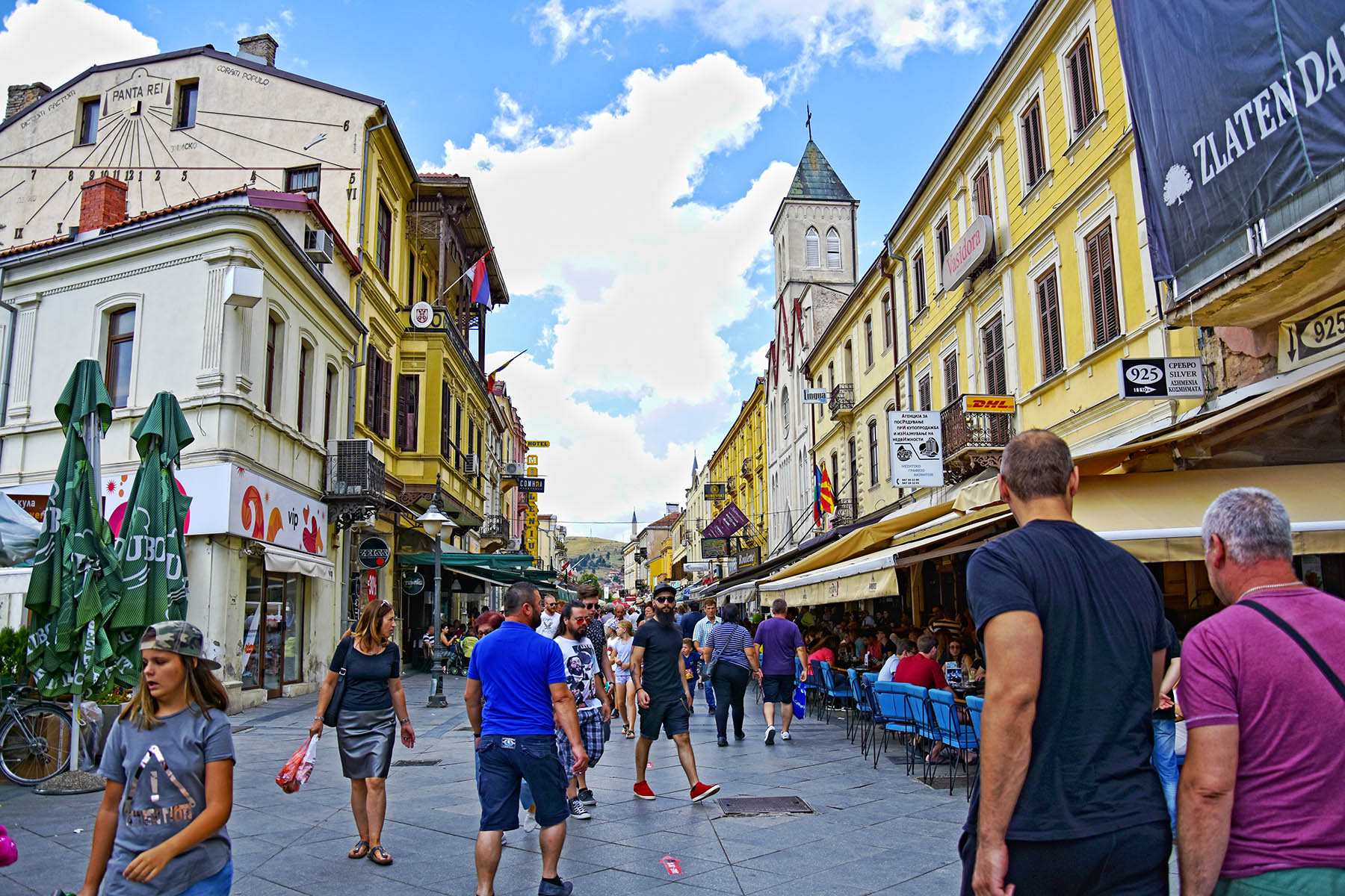 Pedestrian street in Bitola full with people walking and drinking coffee