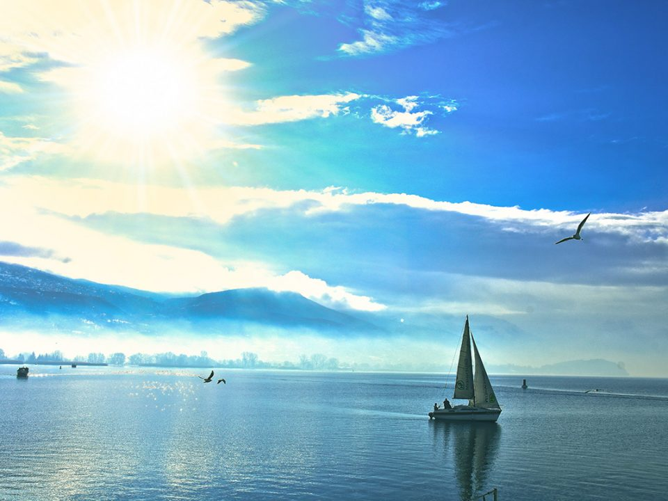 Sunny day in Ohrid lake together with one boat