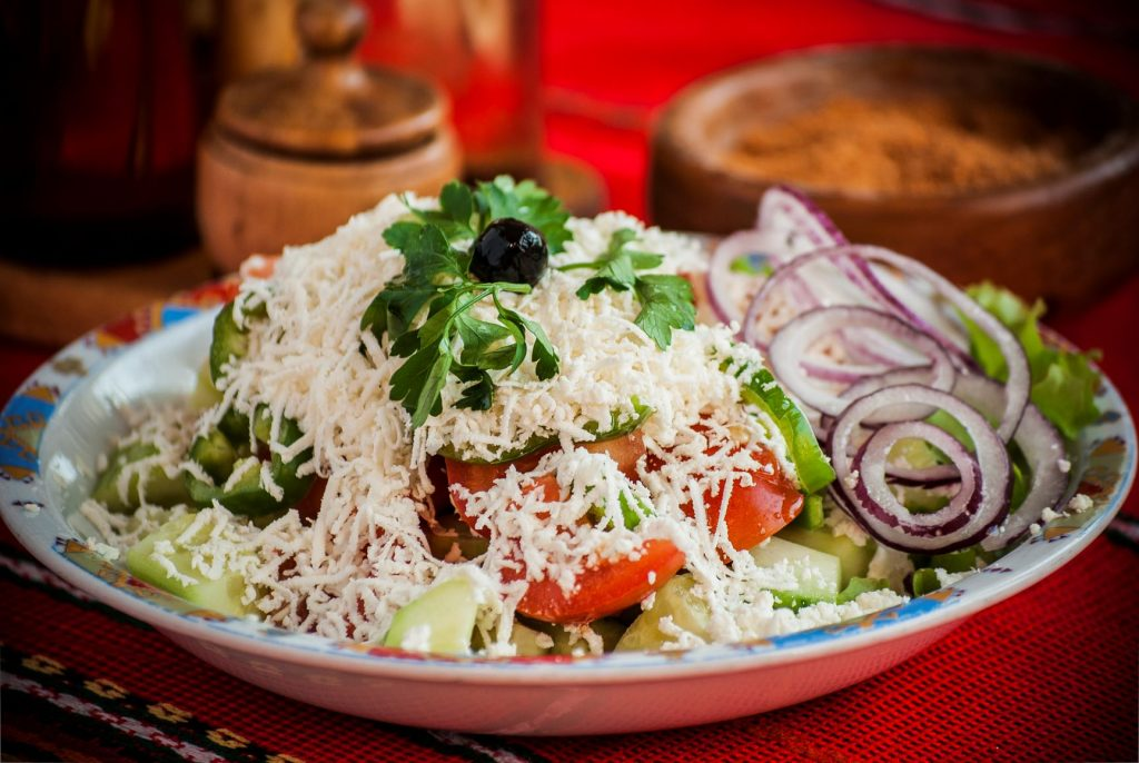 Salad with cheese on the top called Shopska salad
