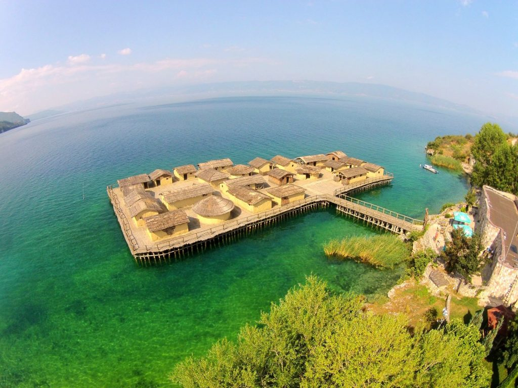 Aerial photo of Bay of Bones, prehistoric settlement on water in the clear water of Ohrid lake
