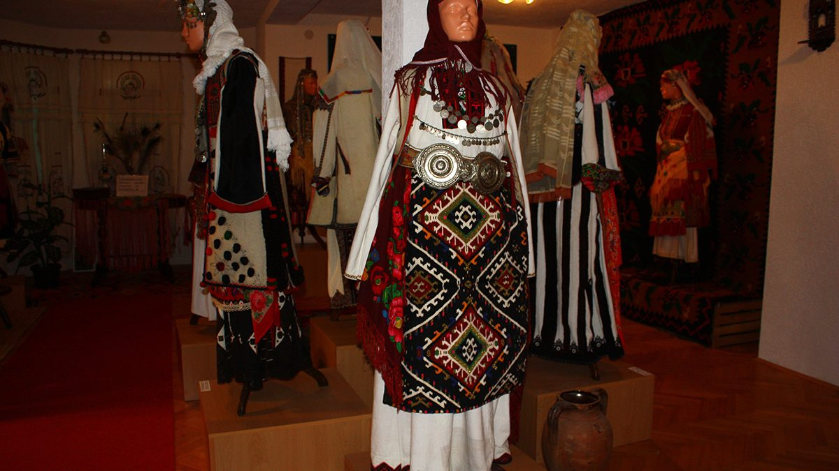Dolls wearing traditional clothes in the Ethnological museum in Podmochani village