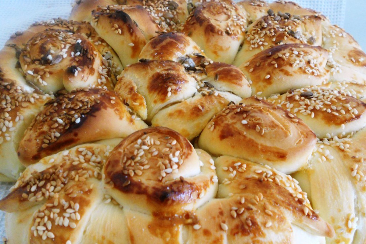 Churek, a beautifully decorated pastry, prepared for special occasions