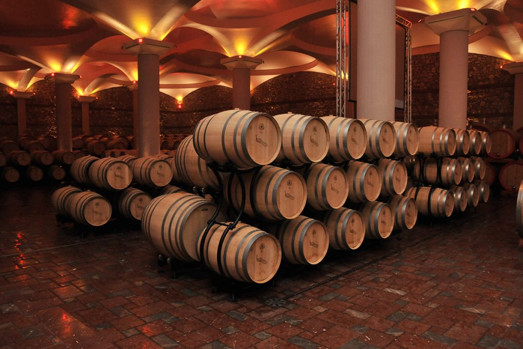 Wooden barrels in the cellar of Stobi winery