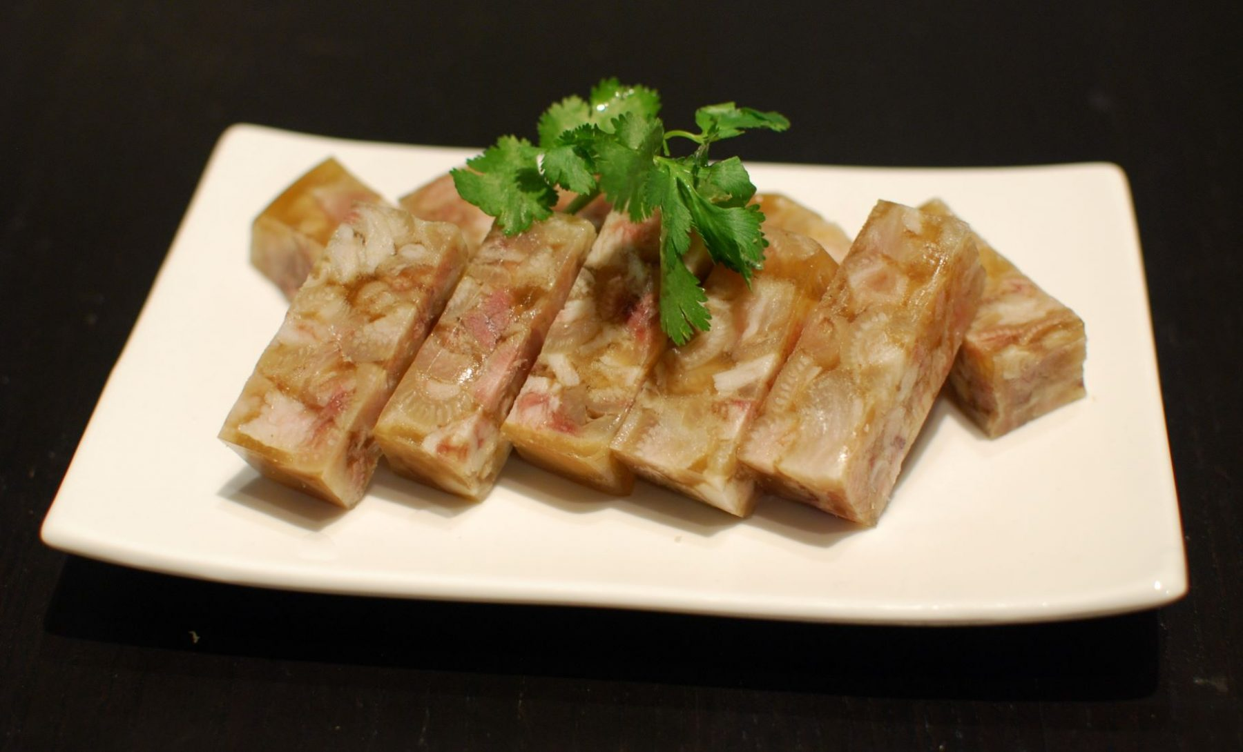 Pacha, a chilled stew (jelly) made of boiled pig head and knees