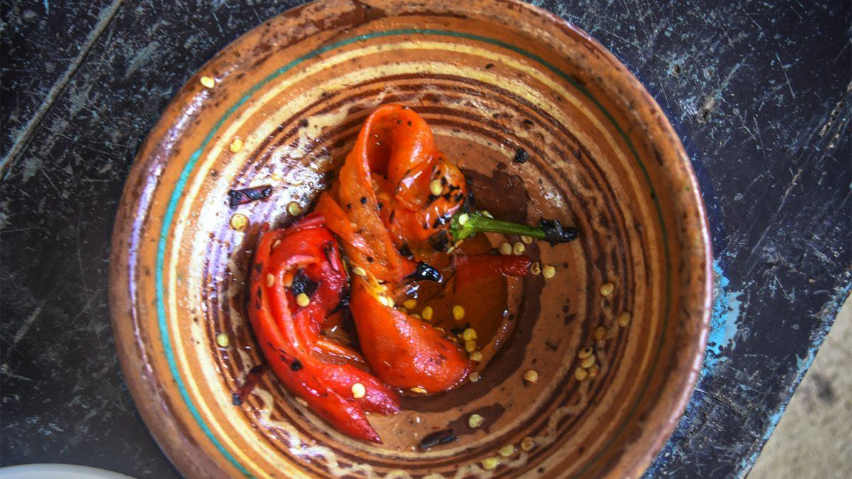 Red peppers in ceramic pot