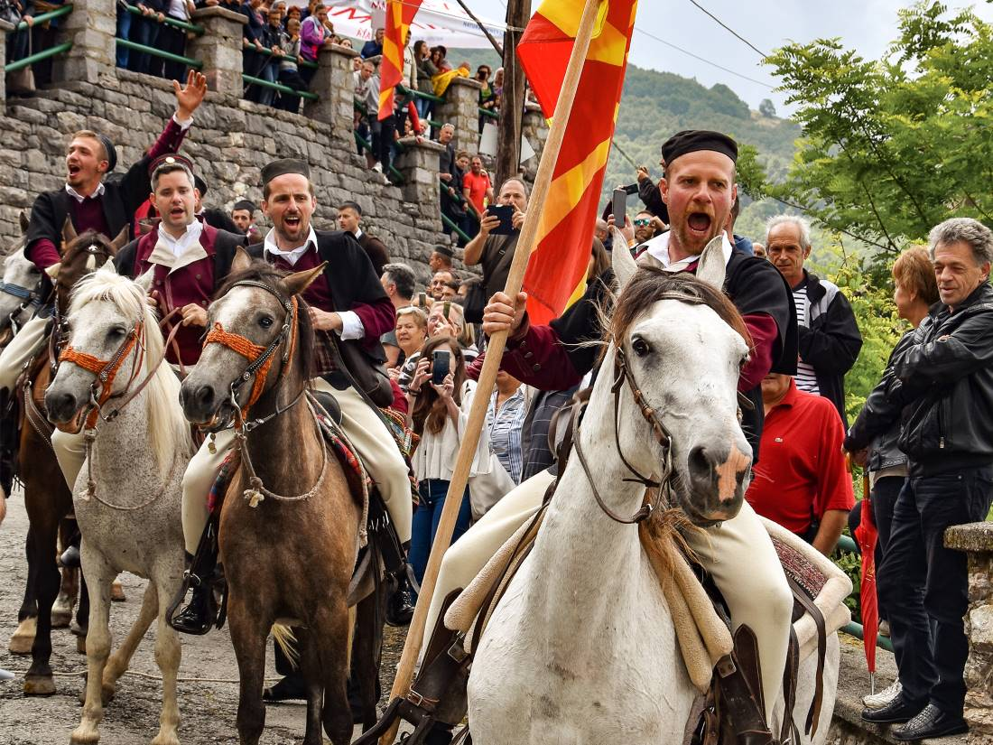 Man on a horse with Macedonian flag on a traditional wedding in Galichnik village