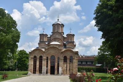 Monastery with 3 domes with clouds in the background, located in Gratchanica, Kosovo