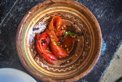 Two red peppers in ceramic plate