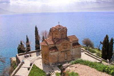 Church of St. John and Ohrid lake with sun rays on the background