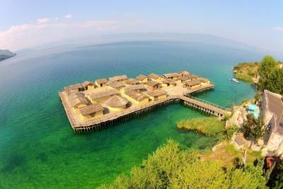 Reconstruction of prehistoric settlement on water with 24 wooden houses conected to the land with wooden bridge, in Ohrid lake.