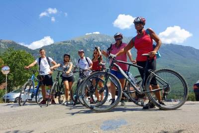 6 persons with bikes with Galichica mountain in the background