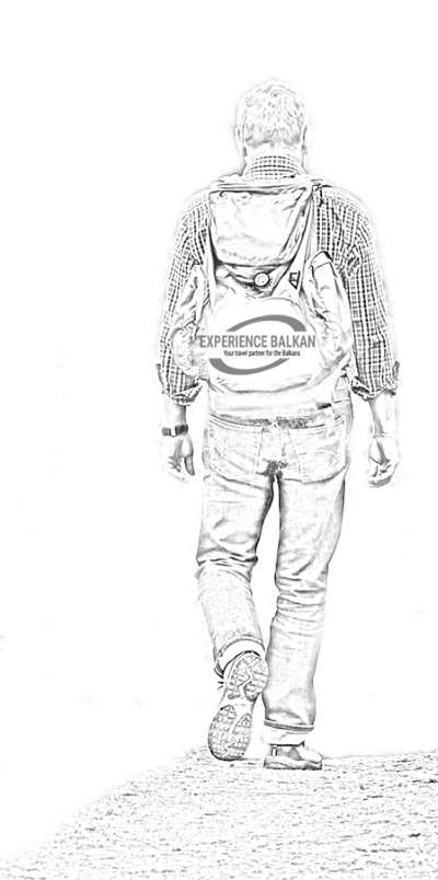 White-Black image of man wearing backpack with Experiencebalkan logo