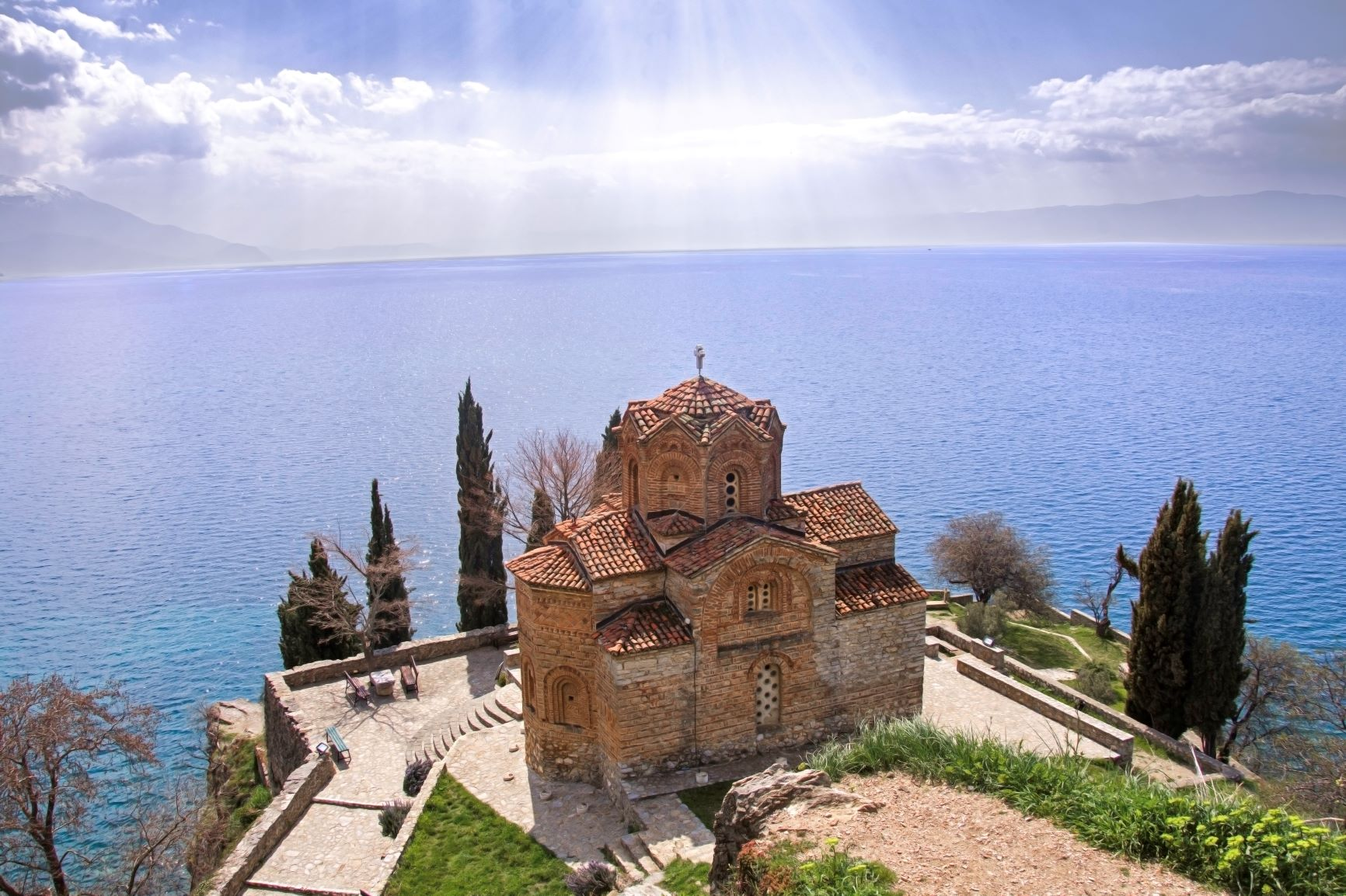 Church of St. John and Ohrid lake with sun rays on the backround