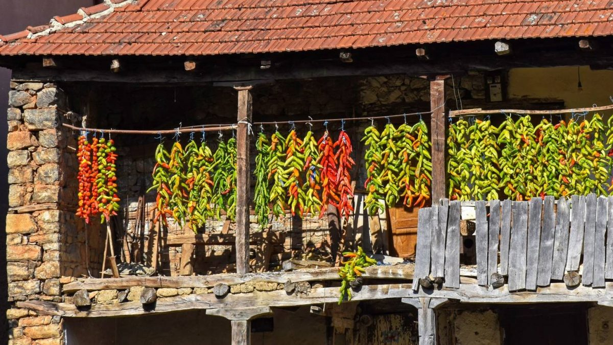 Old house with green and red peppers drying on the balcony in Kuratica village in Ohrid region.