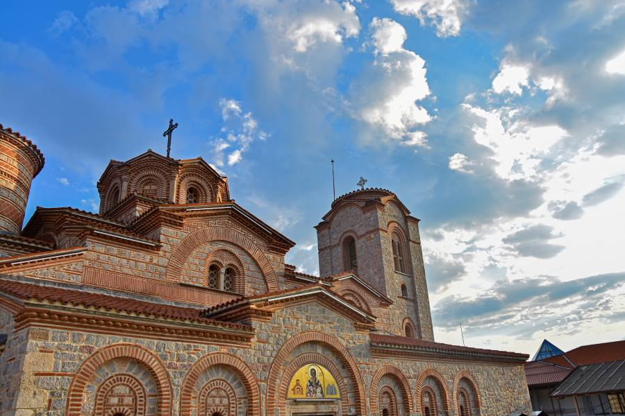 Saint Clement church in Plaosnik settlement with clouds and blue sky in the background