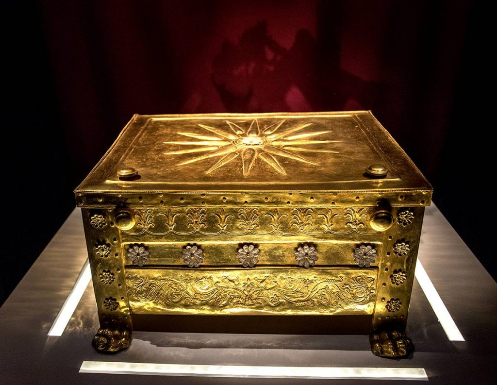 Golden sarcophagus with sun with 16 rays, the flag of ancient Macedonia